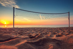 Volleyball net and sunrise on the beach Royalty Free Stock Images