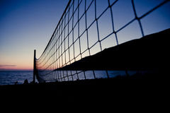 Volleyball net at sunset Royalty Free Stock Image