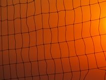 Volleyball net on sunset sky. Volleyball net silhouette against orange sunset sky Stock Photo