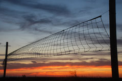 Volleyball net on sunset sky background Stock Photo