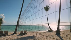 Volleyball net on tropical beach, sunrise and caribbean sea. Punta Cana, Dominican Republic.  stock video footage
