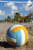 Volleyball net, volleyball on beach and palm trees Royalty Free Stock Image