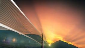 Volleyball netto bij zonsondergangachtergrond stock afbeeldingen