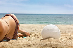 Volleyball next to a Woman Royalty Free Stock Photos