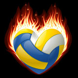 Volleyball op brand in de vorm van hart Royalty-vrije Stock Foto's