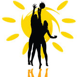 Volleyball play two girl silhouette on the sun Royalty Free Stock Photos