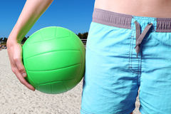 Volleyball player with ball at the beach Royalty Free Stock Images