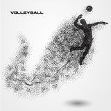 Volleyball player ball of a silhouette from particle. Royalty Free Stock Images