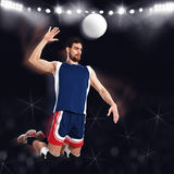 Volleyball player beats ball. Jumping volleyball player ready to beat ball royalty free stock photos