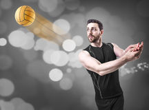 Volleyball player on black uniform on black bokeh background Stock Image