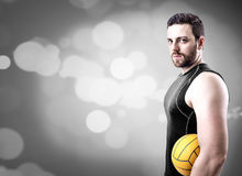 Volleyball player on black uniform on blue bokeh background Stock Photography