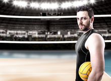 Volleyball player on black uniform on volleyball court.  Royalty Free Stock Image