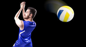 Volleyball player on blue uniform on black background.  Royalty Free Stock Photos