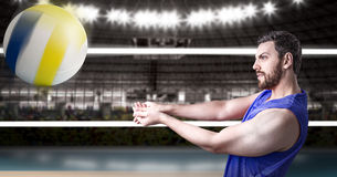 Volleyball player on blue uniform in volleyball court.  Stock Photography