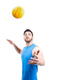 Volleyball player on blue uniform on white background.  Royalty Free Stock Image