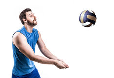 Volleyball player on blue uniform on white background Royalty Free Stock Images