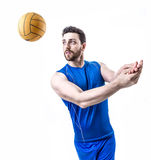 Volleyball player on blue uniform on white background.  Stock Photo