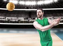 Volleyball player on green uniform on volleyball court Stock Images