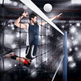 Volleyball player hits the ball Stock Image
