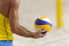 Volleyball Player. Is a male athlete volley ball player getting ready to serve the ball Stock Images