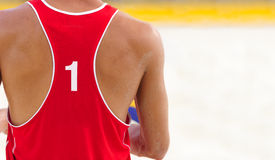 Volleyball Player. Is a male athlete volley ball player getting ready to serve the ball Stock Image