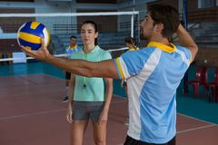 Volleyball player practicing with coach Royalty Free Stock Photo