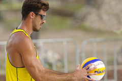 Volleyball Player. PUERTO, VALLARTA, JALISCO, MEXICO - October 9 - 2015 An professional beach volleyball player from the Italian's men team is getting ready to Royalty Free Stock Photography