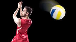 Volleyball player on red uniform in black background Royalty Free Stock Photo
