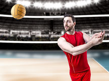 Volleyball player on red uniform on volleyball court.  Stock Image