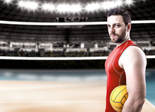Volleyball player on red uniform on volleyball court Stock Image