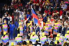 Volleyball player Sergey Tetyukhin carrying the Russian flag leading the Russian Olympic team in the Rio 2016 Opening Ceremony Royalty Free Stock Images
