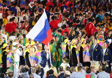 Volleyball player Sergey Tetyukhin carrying the Russian flag leading the Russian Olympic team in the Rio 2016 Opening Ceremony Stock Photography