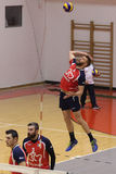 Volleyball player serves the ball. Volleyball player pictured in action during the Romanian League One game between CSM Bucharest and Stiinta Explorari Baia Mare Royalty Free Stock Images