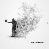 Volleyball player of a silhouette from particle. Stock Photo