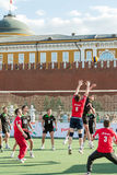 Volleyball player tries to block the ball. MOSCOW - MAY 26: Volleyball player tries to block the ball on VIII Forum Ready for Labor and Defense on May 26, 2012 Stock Images