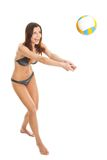 Volleyball player woman in swimwear Stock Image