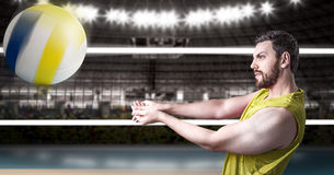 Volleyball player on yellow uniform in volleyball court.  Royalty Free Stock Image