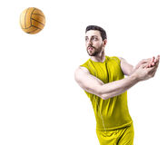 Volleyball player on yellow uniform on white background Stock Image