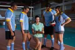 Volleyball players discussing with female coach Stock Images