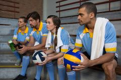 Volleyball players sitting on steps Stock Photography