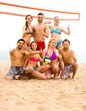 Volleyball players posing near sea Royalty Free Stock Image