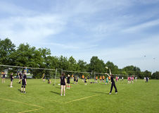Volleyball playing fields. Youth Volleyball tournament in Middelbeers, Netherlands. General view of outdoor playing fields with lots of teenage players. 27th royalty free stock photo