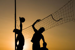 Volleyball playing people silhouettes Royalty Free Stock Images