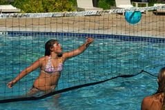 VolleyBall in the Pool. Girls are playing volleyball in the pool Stock Images