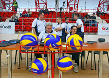 Volleyball referees with ball. Volleyball referees getting ready for the Romanian  Volleyball A1 Division game between Dinamo Bucharest and Arcada Galati. Dinamo Royalty Free Stock Photos