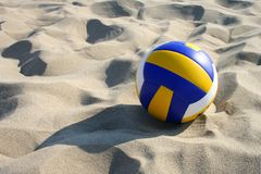 Volleyball in sand. Beachvolleyball lying in sand Stock Photo