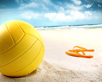 Volleyball in the sand with sandals stock images