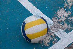 Volleyball in school gym indoor. A professional volleyball on the floor of a gym. The ball lying in the corner of the field. Indoor school gymnasium image stock photography