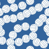 Volleyball seamless pattern. Sports balls on blue background. Royalty Free Stock Photo