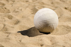 Volleyball sitting in sand Stock Image